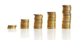 Stacks of gold coin. S in increasing height isolated on white background Royalty Free Stock Image