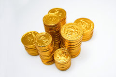 Stacks of gold coins isolated on white background.  stock images