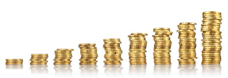 Stacks of gold coins. Increasingly higher stacks or piles of gold coins on a white background Royalty Free Stock Photo
