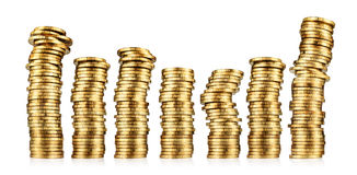 Stacks of gold coins. Stacks or piles of gold coins on a white background Royalty Free Stock Photography