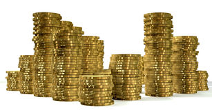 Stacks Of Gold Coins. A closeup shot of various stacks of gold coins on an  background Stock Photos