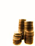 Stacks of Gold Coins. Several stacks of gold coins isolated on white background Stock Images