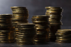 Stacks of gold coins. On black background Royalty Free Stock Photo