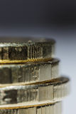 Stacks of gold coins. On blurred background close up Royalty Free Stock Photography