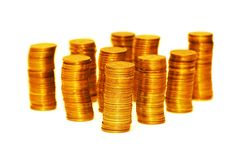 Stacks of gold coins isolated on the white. Stacks of gold  coins isolated on the white Royalty Free Stock Photography