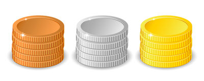 Stacks of gold, silver and bronze coins in different heights with gold the tallest in two different variants Stock Image