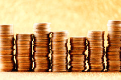 Stacks of golden coins arranged as a graph Royalty Free Stock Images