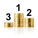 Stacks of golden coins as podium. Royalty Free Stock Images
