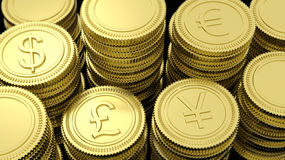 Stacks of golden coins with various currency symbols Royalty Free Stock Photo