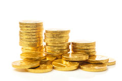 Stacks of golden coins. On white background royalty free stock photos