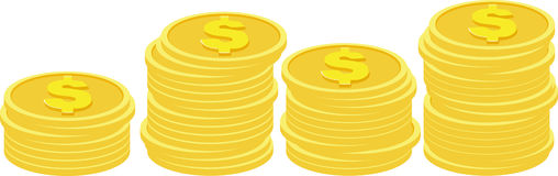 Stacks of golden coins  on a white background. Stock Images