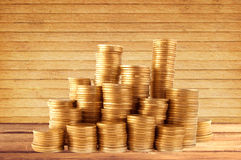 Stacks of golden coins on wooden table background Stock Photo