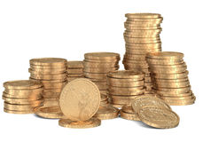 Stacks of golden dollar coins on white Royalty Free Stock Photography