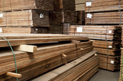 Stacks of hardwood. Tacks of a hardwood in lumber warehouse ready for transportation Stock Photography