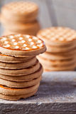 Stacks of honey cookies. On wooden board Royalty Free Stock Photography