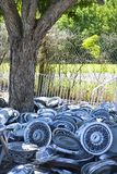 Stacks of hubcaps on ground. Stock Photo
