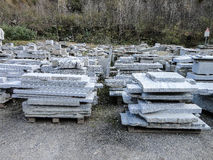 Stacks of industrial slabs of granite placed in a yard Stock Images