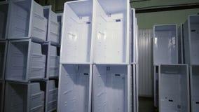 Stacks of inner cases for domestic fridges in plant storage. Stacks of white plastic inner cases for domestic fridges stand in production plant large storage stock video