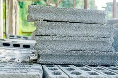 Stacks of interlocking stones for installing driveway landscapin Royalty Free Stock Photo