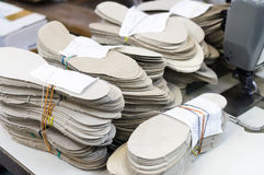 Stacks of leather shoe insoles. Blank for shoe production stock photo