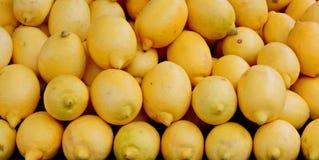Stacks of lemons. On street market Stock Images