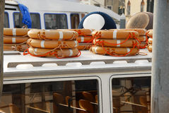 Stacks of life belts on boat Royalty Free Stock Photos