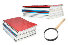 Stacks of magazines and loupe Royalty Free Stock Images