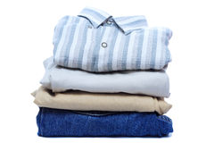 Stacks of manly colored clothes. On white background Royalty Free Stock Photography