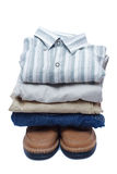 Stacks of manly colored clothes. On white background Royalty Free Stock Photo