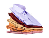 Stacks of many colored clothes. Isolated on a white background Royalty Free Stock Photography