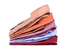 Stacks of many colored clothes. Isolated on a white background Stock Image