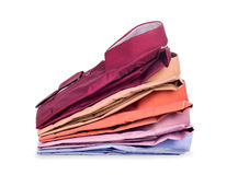 Stacks of many colored clothes. Isolated on white background Stock Images