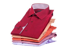Stacks of many colored clothes. Isolated on a white background Stock Photos
