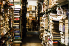 Stacks with many old books Stock Image