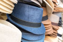 Stacks of men`s hats. On the street market Stock Images