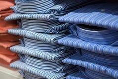 Stacks of Mens Fashionable Shirts Stock Photo