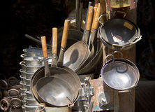 Stacks of metal cookware on market Stock Image