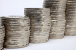Stacks of money coins. On a white background royalty free stock images