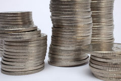 Stacks of money coins. On a white background stock photography