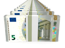 Stacks of money. Five euros. Stock Photo