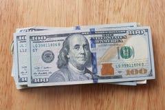 Stacks of money. Hundred Dollars bills in large stack Stock Photo