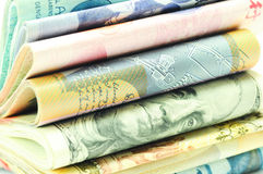Stacks of Money - macro 3/4 view. Close up 3/4 view of Stacks of money from different countries Royalty Free Stock Photos