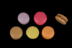 Stacks of multicolored macaroon isolated on black background. Frame stock photo