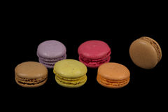 Stacks of multicolored macaroon isolated on black background. Frame stock images