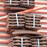 Stacks of new roof tiles on roof ready for installation Royalty Free Stock Images