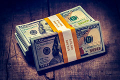 Stacks of new 100 US dollars 2013 banknotes bills Royalty Free Stock Photo