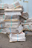 Stacks of Newpapers on urban street Stock Photography