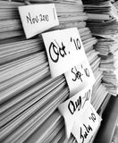 Stacks of Newspapers with Dates Stock Photo