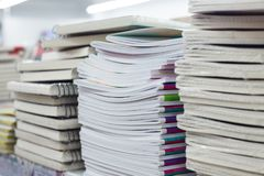 Stacks of notebooks in chancery shop closeup stock photos