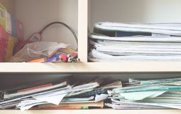 Stacks of notebooks and school supplies - mess Stock Images